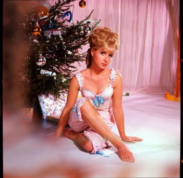 angela_douglas_christmas_tree_publicity_pose_and_feet