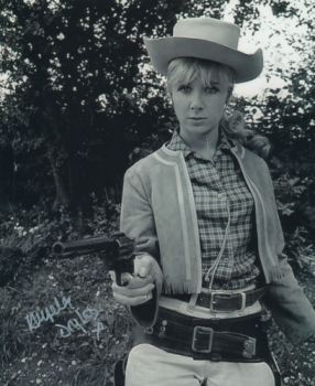angela_douglas_pointing_pistol_in_carry_on_cowboy