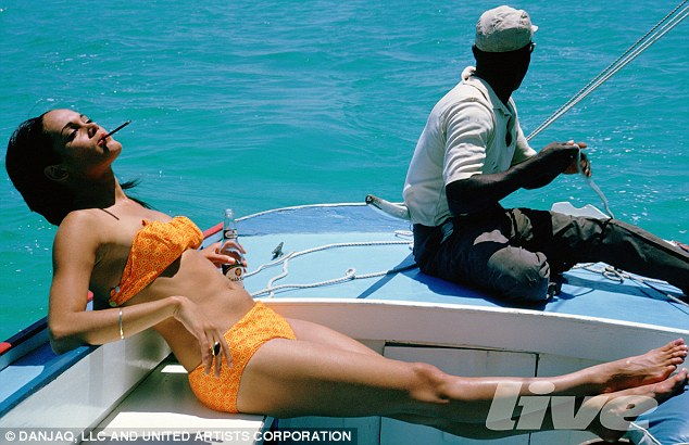 https://georgesjournal.files.wordpress.com/2012/03/thunderball_martine_beswicke_smoking_on_boat.jpg