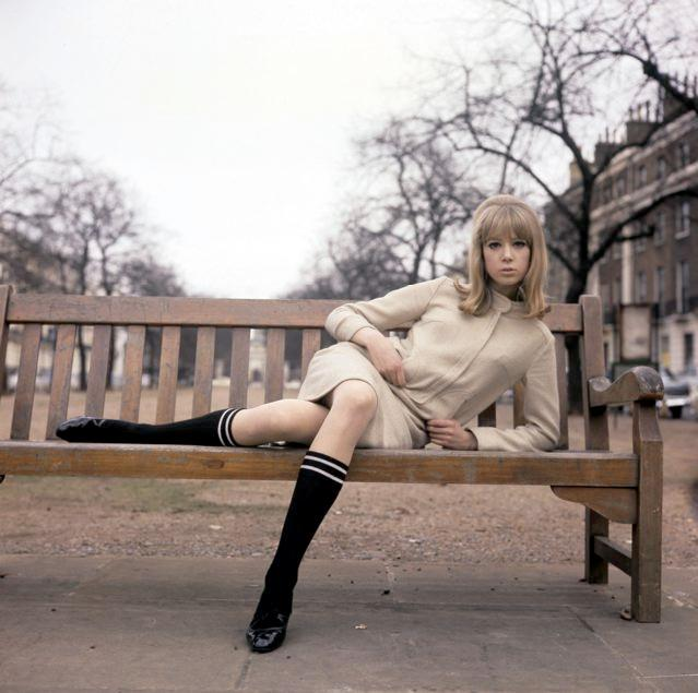 pattie_boyd_in_long_socks_on_park_bench.
