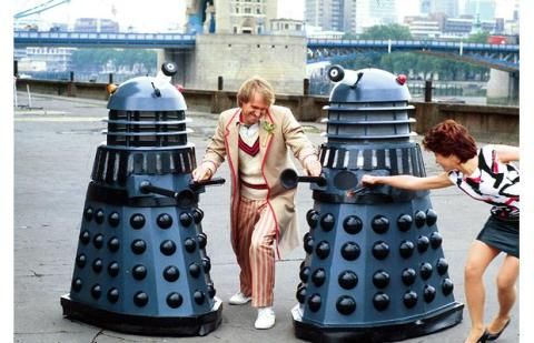doctor_who_peter_davison_and_janet_fielding_in_publicity_shot_with_daleks_at_tower_bridge