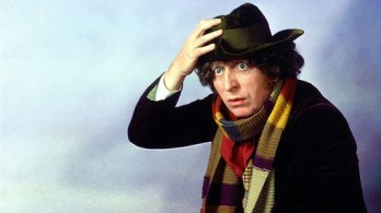 doctor_who_tom_baker_publicity_shot_against_blue_background