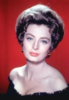 capucine_with_hair_up_and_cleavage