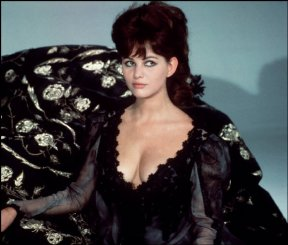 claudia_cardinale_black_dress_and_cleavage_by_phillipe_halsman