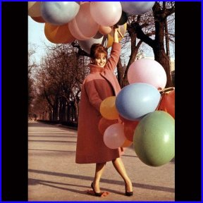 claudia_cardinale_holding_on_to_balloons