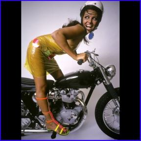 claudia_cardinale_in_plastic_dress_on_motorbike
