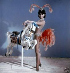 claudia_cardinale_with_a_carousel_horse