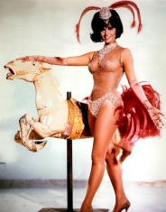 claudia_cardinale_with_a_carousel_horse_2