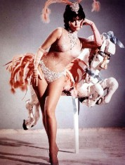 claudia_cardinale_with_a_carousel_horse_3