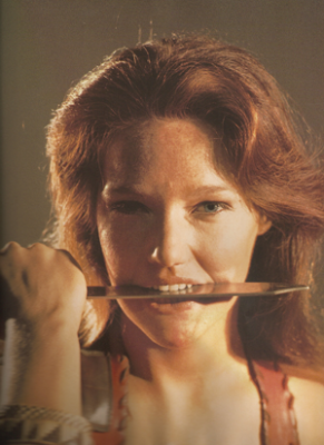 doctor_who_louise_jameson_with_dagger_between_teeth