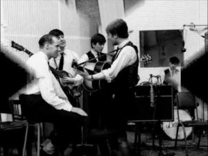 george_martin_paul_mccartney_george_harrison_and_john_lennon_record_please_please_me