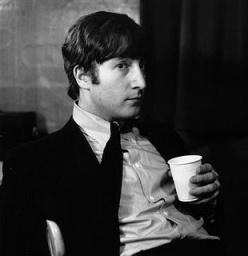john_lennon_with_a_cup_of_tea_possibly_during_the_recording_of_please_please_me