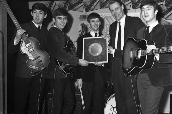 the_beatles_and_george_martin_pose_with_a_silver_disc_of_please_please_me