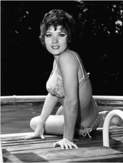 deborah_watling_on_edge_of_pool_in_bikini_1971
