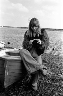 katy_manning_sitting_on_boat_in_ludicrous_furry_jacket