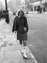 katy_manning_walking_down_street_smoking_a_cigarette_1965