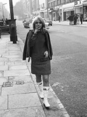 katy_manning_walking_down_street_smoking_a_cigarette_1965