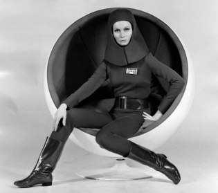 catherine_schell_in_an_egg_chair_in_moon_zero_two