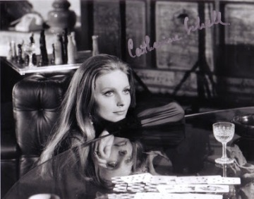 catherine_schell_reflected_in_glass-table_in_on_her_majesty's_secret_service