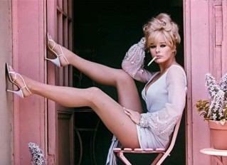 elke_sommer_in_pale_blue_and_heels_with_cigarette