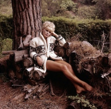 elke_sommer_showing_legs_in_wood