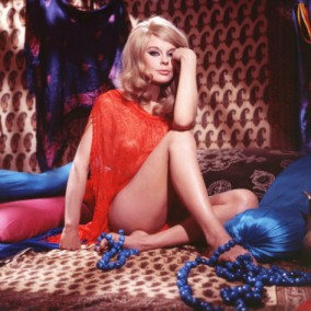elke_sommer_wearing_a_red_wrap_in_a_bedhouin_tent