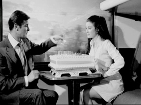 live_and_let_die_roger_moore_and_jane_seymour_on_the_train_set_with_a_birthday_cake