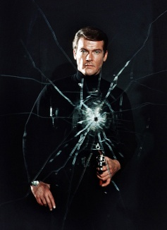 live_and_let_die_roger_moore_pose_bullet_hole_in_cracked_mirror