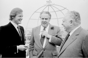 live_and_let_die_roger_moore_with_cubby_broccoli_and_harry_saltzman_during_press_introduction_as_the_new_james_bond