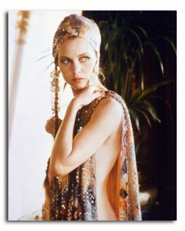 michelle_phillips_in_ornate_head_dress_and_wrap