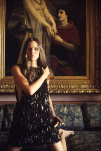 michelle_phillips_posing_in_front_of_painting