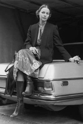 michelle_phillips_posing_on_car_boot_with_hair-tied_back_by_cynthia_mcadams