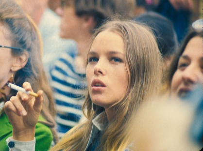 michelle_phillips_smoking_in_a_festival_crowd