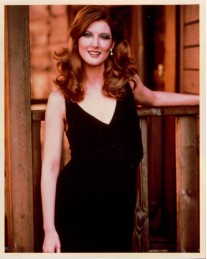 annette_o'toole_in_black_dress_with_curly_hair_2