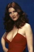 annette_o'toole_in_red_dress_with_curly_hair