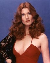 annette_o'toole_in_red_dress_with_curly_hair_2
