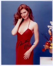 annette_o'toole_in_red_dress_with_curly_hair_3