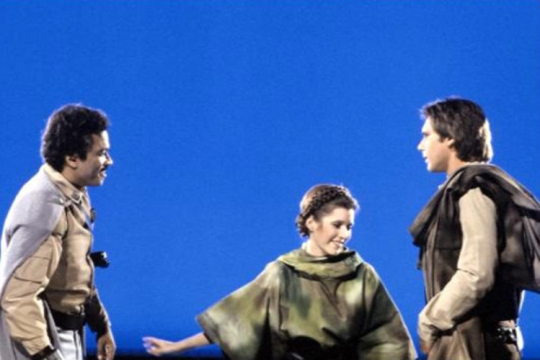 return_of_the_jedi_billy_dee_williams_carrie_fisher_harrison_ford_against_blue_screen