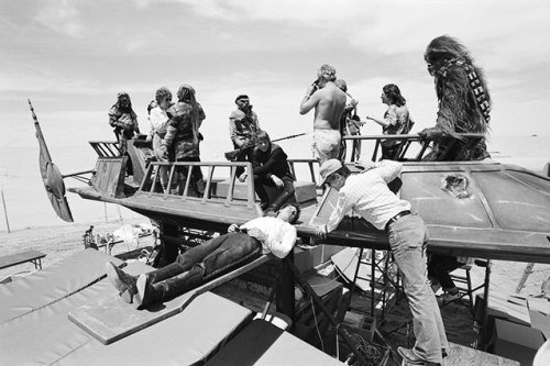 return_of_the_jedi_harrison_ford_relaxes_on_a_plank_between_shots_on_jabba's_barge
