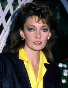 sarah_douglas_in_black_jacket_and_yellow_shirt