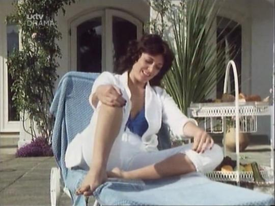 sarah_douglas_in_white_suit_bare_feet