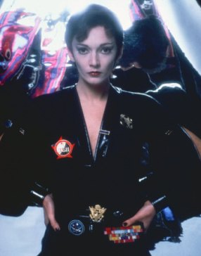 sarah_douglas_ursa_in_superman_2_showing_off_her_insignia_trophies