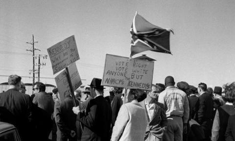 john_f_kennedy_assasination_anti-kennedy_protestors_await_jfk's_arrival_at_love_field_airport_dallas_on_november_22_1963