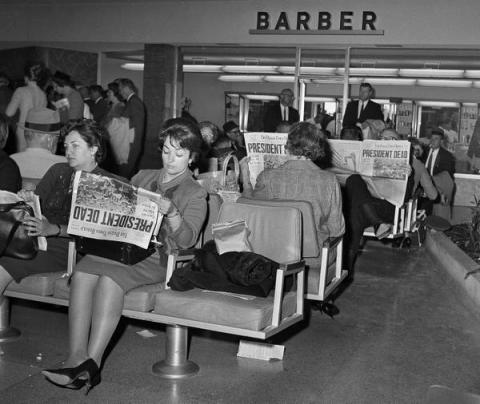 john_f_kennedy_assasination_people_in_dallas_love_field_airport's_departure_lounge_read_of_kennedy's_death_november_22_1963