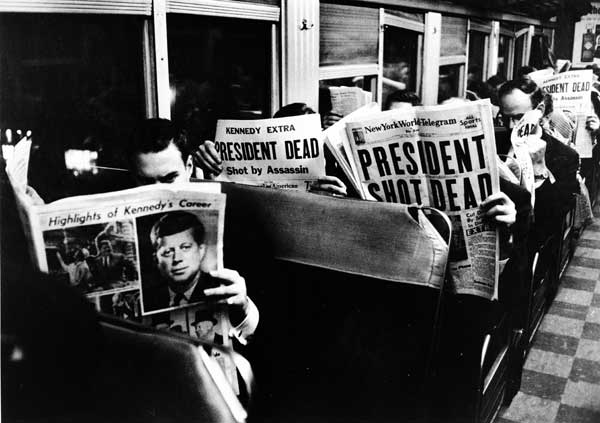 john_f_kennedy_assassination_commuters_reading_newspapers