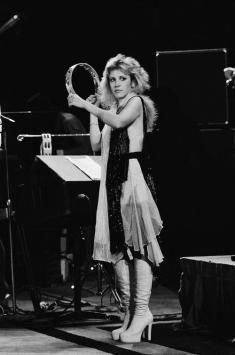 stevie_nicks_with_tambourine_and_wearing_white_platform_boots