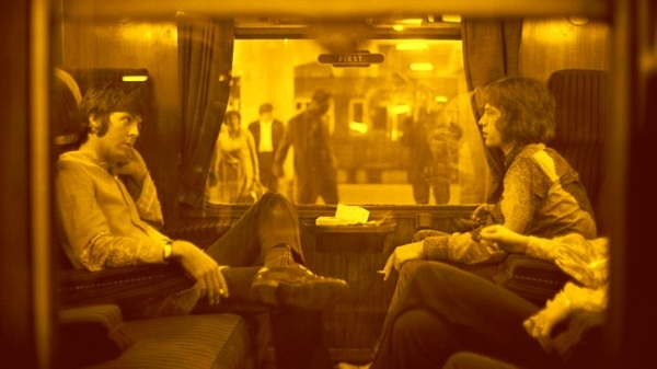 paul_mccartney_and_mick_jagger_1967_share_a_train_carriage_golden