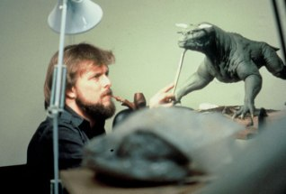 ghostbusters_behind_the_scenes_beardy_pipe-toting_modeller_with_zuul_dog
