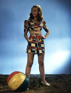 jean_simmons_in_multi-coloured_outfit_with_beach_ball