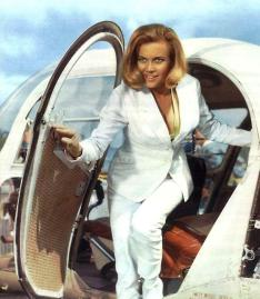 goldfinger_honor_blackman_bikini_publicity_shot_getting_out_of_helicopter